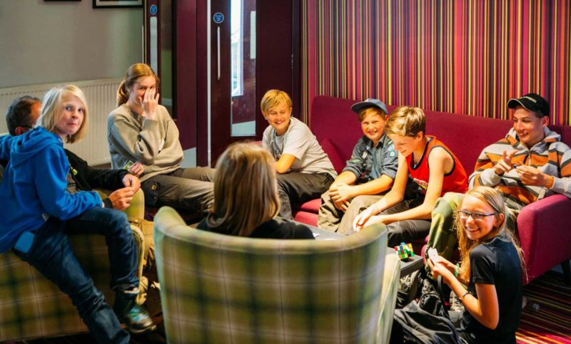 Group of kids sitting round table at Safestay for school trip