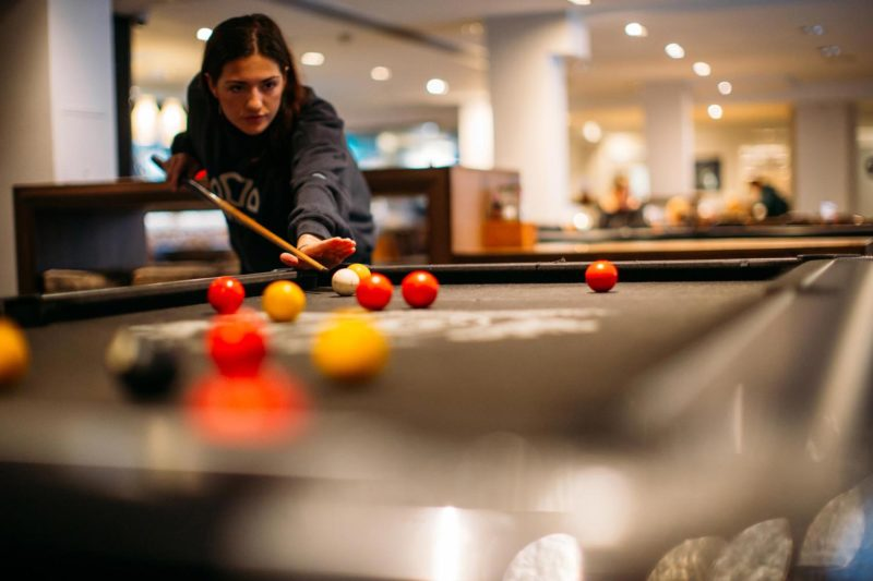 Woman playing pool at Safestay Hostel